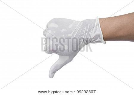 Hand wearing medical glove show thumb down