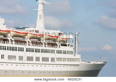 Luxury White Cruise Ship On A Clear Day With Blue Sky.