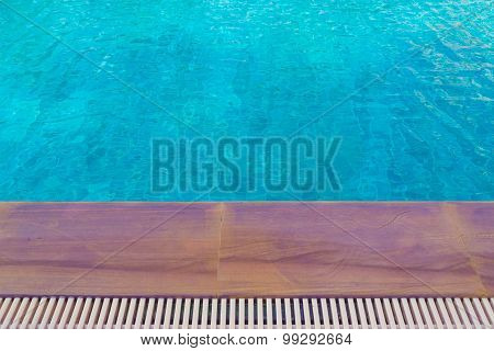 Blue Swimming Pool With Sunny Reflections.
