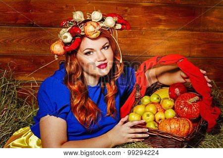 Girl Is Holding Basket With Crop Of Vegetables And Fruit.