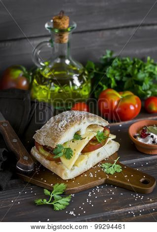 Sandwich With Tomato And Cheese, Served On A Cutting Board On Dark Wooden Surface. Healthy Breakfast