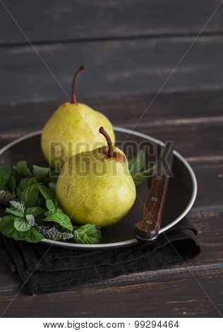 Fresh Pears And Mint On A Brown Plate On A Dark Wooden Surface
