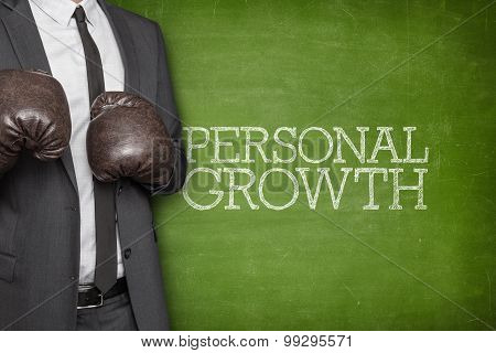 Personal growth on blackboard with businessman on side
