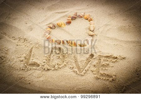 Word Love Written On Sand At The Beach, Heart Of Shells