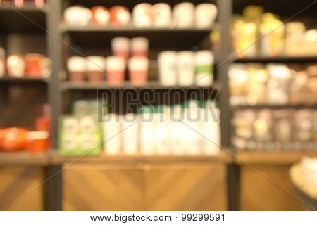 Abstract blurry retail store water glass shelf