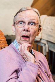 picture of matron  - Surprised old matron woman looking at camera - JPG