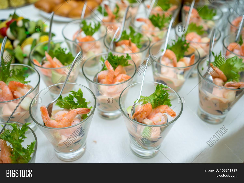 shrimp or prawn cocktail snacks in shot glasses on table. Black Bedroom Furniture Sets. Home Design Ideas