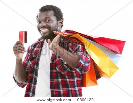 African American man with colorful paper bags and credit card isolated on white