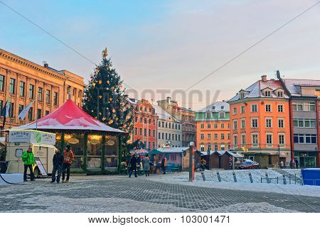 Traditional Christmas Market In Riga With A Beautifully Decorated Christmas Tree