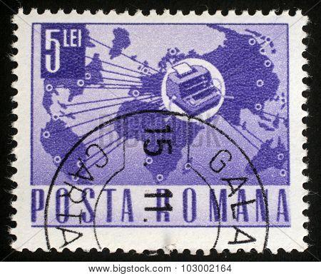 ROMANIA - CIRCA 1967: A stamp printed in Romania shows Telex instrument and world map, circa 1967