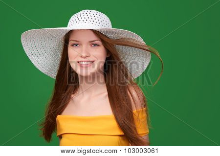Closeup portrait of woman in straw hat