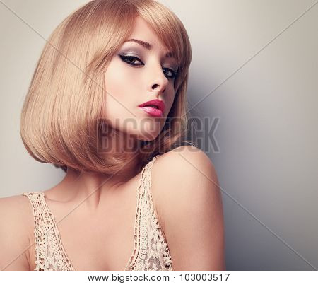Beautiful Glamour Makeup Blond Woman With Short Hair Style. Closeup