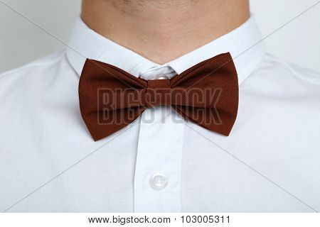 Brown Bow Tie On A White Shirt