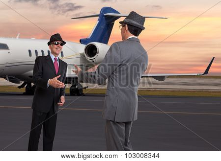 Two business men meeting at the executive airport