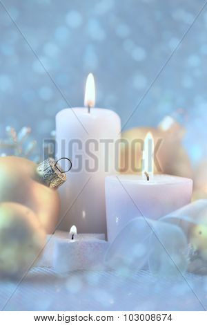 Light Christmas Decorations with Candles, baubles and magic snow background