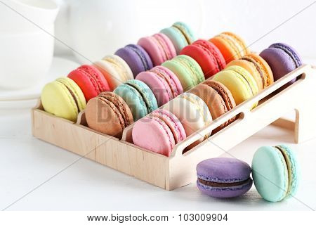 French Colorful Macarons On The Wooden Stand