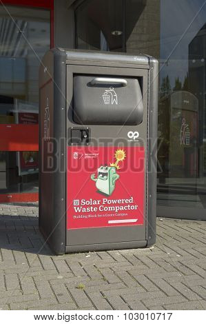 GRONINGEN NETHERLANDS - AUGUST 22 2015: Small waste compactor on the groningen university campus. By compressing its contents the unit gains capacity so it doesn't have to be emptied as often