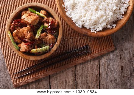 Kung Pao Chicken Fillets In A Bowl Close Up. Horizontal Top View