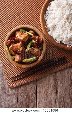 Kung Pao Chicken In A Bowl And Rice. Vertical Top View