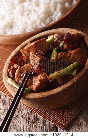 Kung Pao Chicken In A Bowl Close Up And Rice. Vertical
