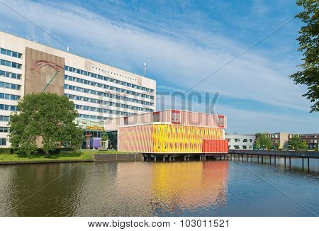 GRONINGEN NETHERLANDS - AUGUST 22 2015: Modern orange building on the groningen university campus. The university counts around 30000 students and is one of the oldest of the country