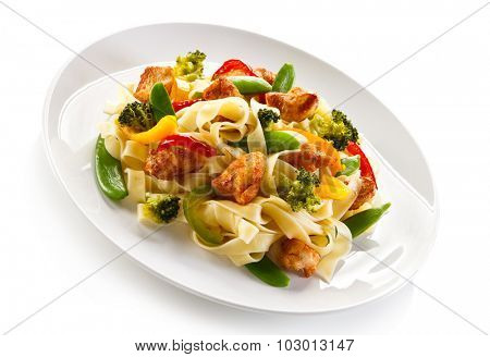 Pasta with chicken nuggets and vegetables