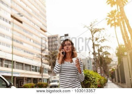 Beautiful Woman Walking On City Palms Avenue