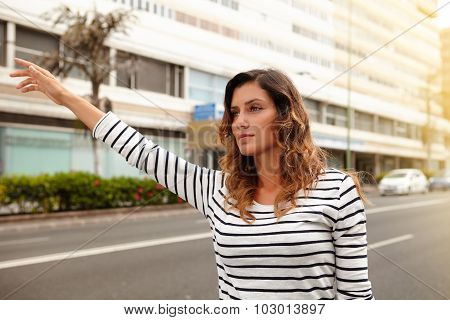 Beautiful Woman Hailing A Cab During The Day