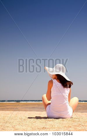 Sitting Woman On The Beach