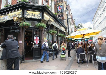 London - June 6: People And Exterior Of Pub, For Drinking And Socializing, Focal Point Of The Commun