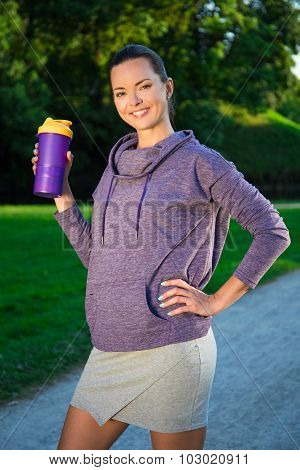 Fitness Woman Drinking Water After Running In Park
