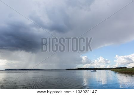 Stormy Lake Landscape With Yachts On Water.