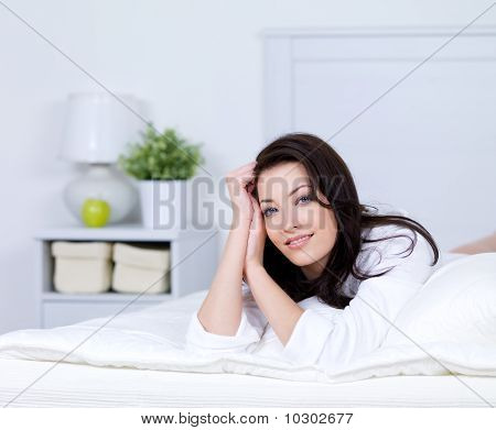 Relaxation Of Beautiful Woman On A Bed
