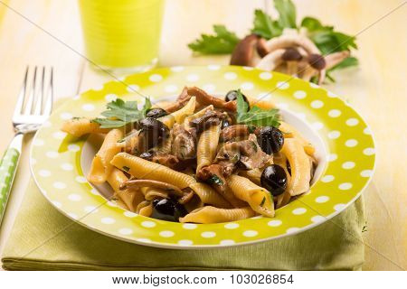 pasta with mushroom and black olives, selective focus