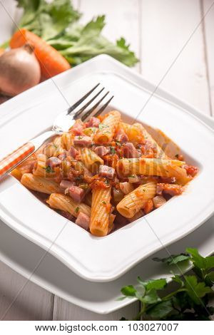 pasta with tomatoes sauce and bacon, selective focus