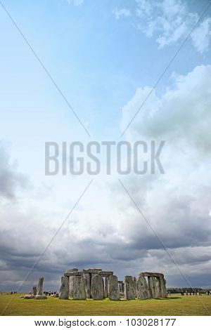 Stonehenge Historic Site On Green Grass Under Dramatic Sky. Stonehenge Is A Unesco World Heritage Si