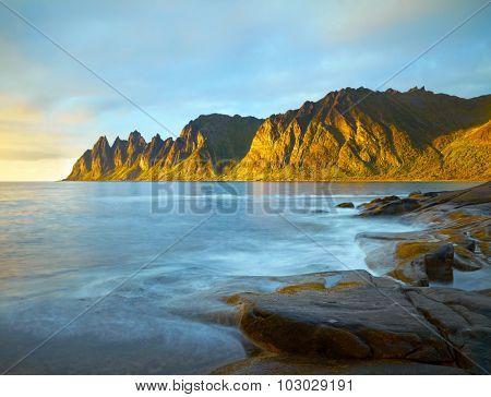 Peaks of the Okshornan mountain in sunset lights. Senja island, Norway