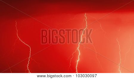 Red colored image of lightning bolt hits