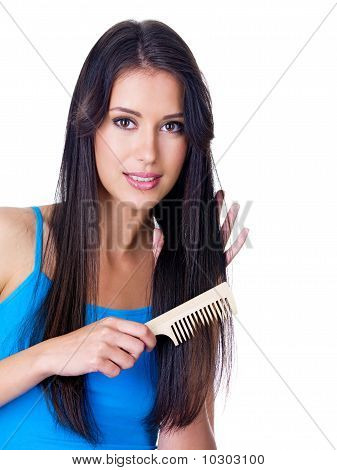 Woman Combing Long Hair