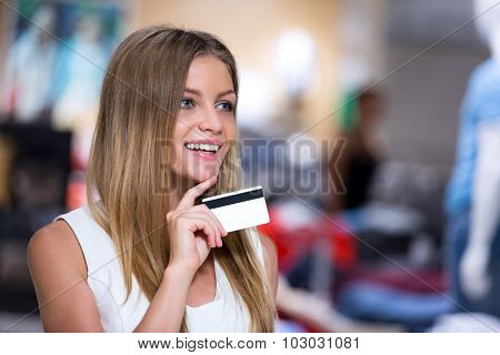 Young girl with a credit card in the store