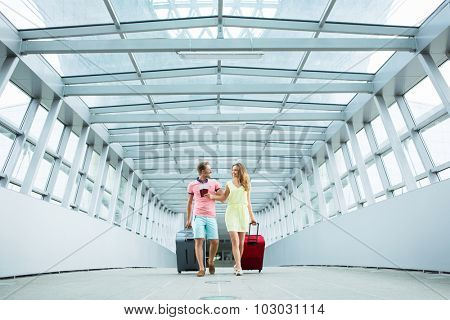 Young couple with a suitcase