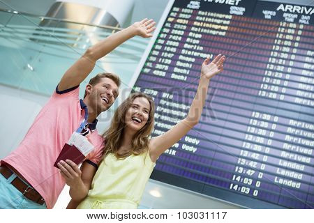 Happy couple at board at the airport