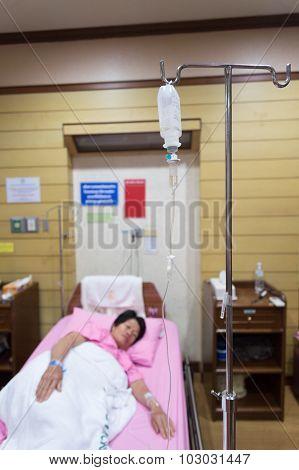 Asia Woman Patient  With Saline Intravenous (iv) Drip