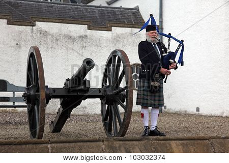 Edinburgh, Scotland, United Kingdom - June 16 : Unidentified Scottish Bagpiper Playing Music With Ba
