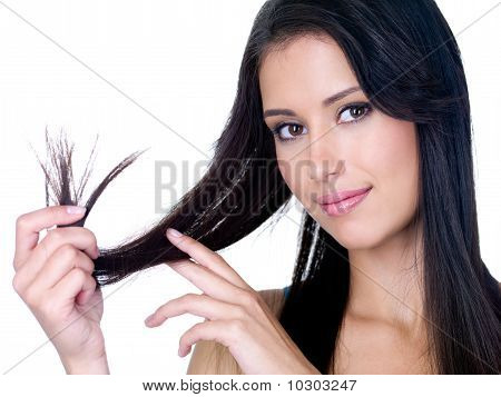 Smiling Woman Holding Ends Of Her Long Hair