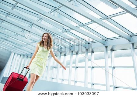 Young woman with a suitcase at the airport