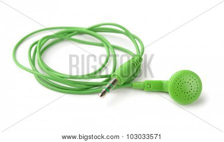 Single green  in ear earphone isolated on white