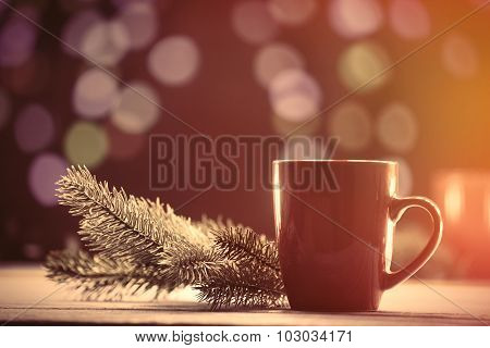 Cup Of Tea And Pine Branch With Christmas Lights