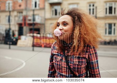 African Woman Blowing Bubble Gum