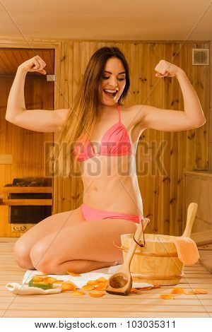 Woman Relaxing In Sauna Showing Off Muscles.